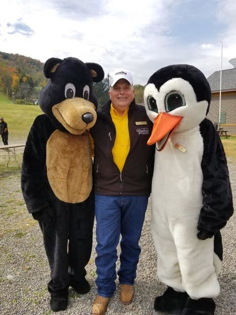 Greek Peak ski resort president Wesley Kryger with mascots Arktos and Filos
